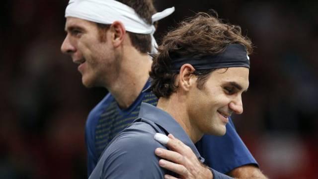 Da hatte er den Rosenkranz noch: Del Potro (l) und Federer (Archiv)