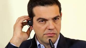 Der griechische Premier Alexis Tsipras vor den Medien (Archiv)