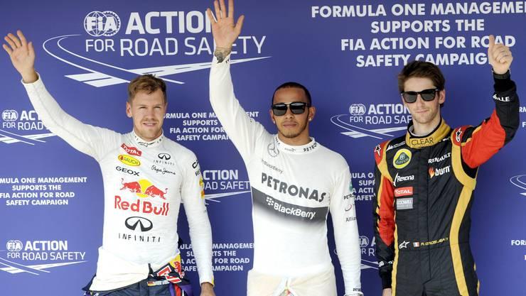 Die ersten drei: Lewis Hamilton (Mitte), mit Sebastian Vettel (links) und Romain Grosjean