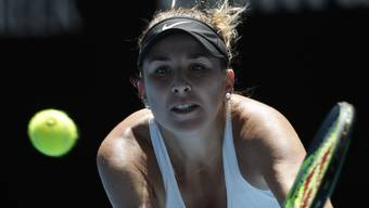 Switzerland's Belinda Bencic keeps eye on the ball for a backhand in a second round match against Thailand's Luksika Kumkhum at the Australian Open tennis championships in Melbourne, Australia, Wednesday, Jan. 17, 2018. (AP Photo/Vincent Thian)