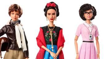 """Barbie-Kollektion """"Inspirierende Frauen"""": v.l. Pilotin Amelia Earhart, Künstlerin Frida Kahlo und Mathematikerin Katherine Johnson. Frida Kahlos Familie protestiert gegen die Vermarktung ihrer Ahnin: Weder besässen die Hersteller die Bildrechte, noch sehe die Puppe dem Vorbild ähnlich."""