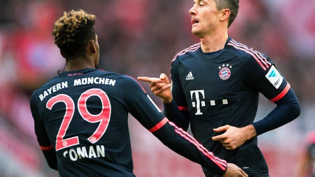 Robert Lewandowski (rechts) ebnete den Bayern mit seinem 25. Saisontreffer den Weg zum Sieg in Köln