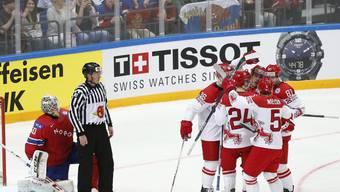 Dänen bejubeln ihren 3:0-Auftaktsieg über Norwegen