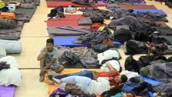 """Migranten in Tijuana: Sie Migranten haben Elend und Gewalt hinter sich gelassen und wollen ihren """"Amerikanischen Traum"""" leben."""