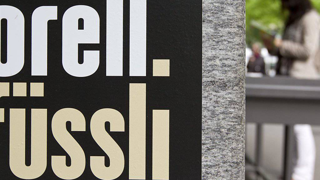 Der Mischkonzern Orell Fuessli erleidet im ersten Halbjahr 2017 einen Gewinneinbruch. (Archiv)