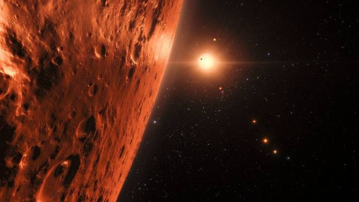 So stellt sich ein Künstler den Blick von einem der Planeten des TRAPPIST-1-Systems auf den Zentralstern vor. (Illustration)