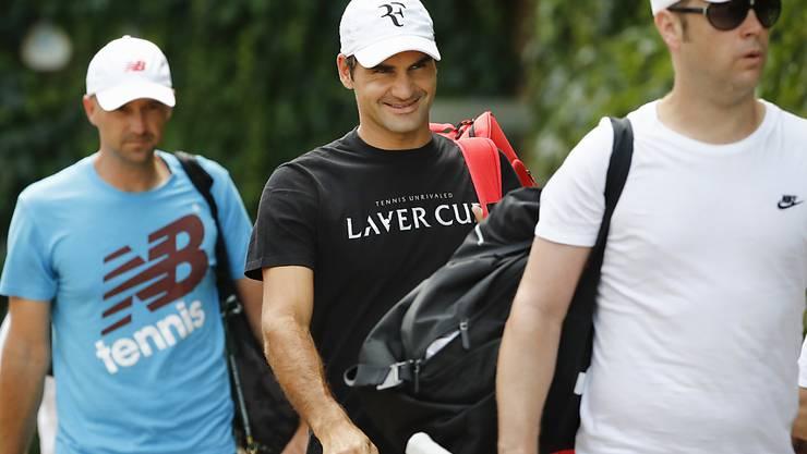 Roger Federer mit seinen Coaches Severin Lüthi (vorne) und Ivan Ljubicic