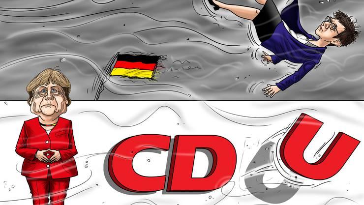 Steht weiterhin auf ihrem bröckelnden Podest, während Annegret Kramp-Karrenbauer davonfliegt: Kanzlerin Angela Merkel.