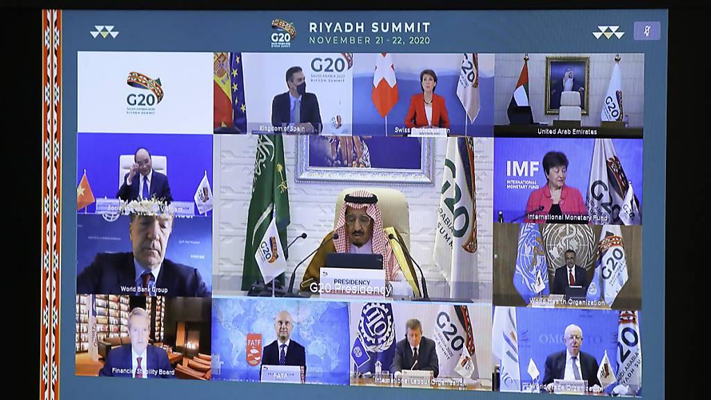 Charles Michel, Präsident des Europäischen Rats (unten), nimmt am virtuellen G20-Gipfel unter Vorsitz Saudi-Arabiens teil.