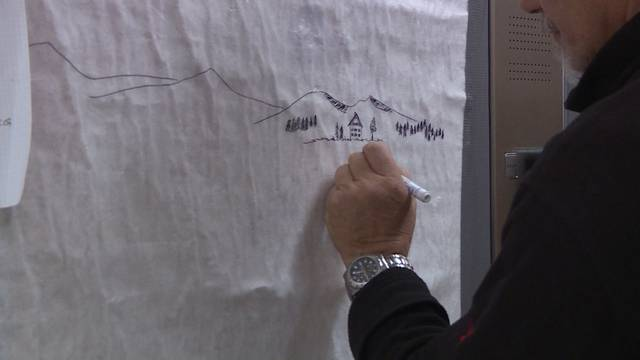 Ingenieur malt Liftbilder im Spital Emmental