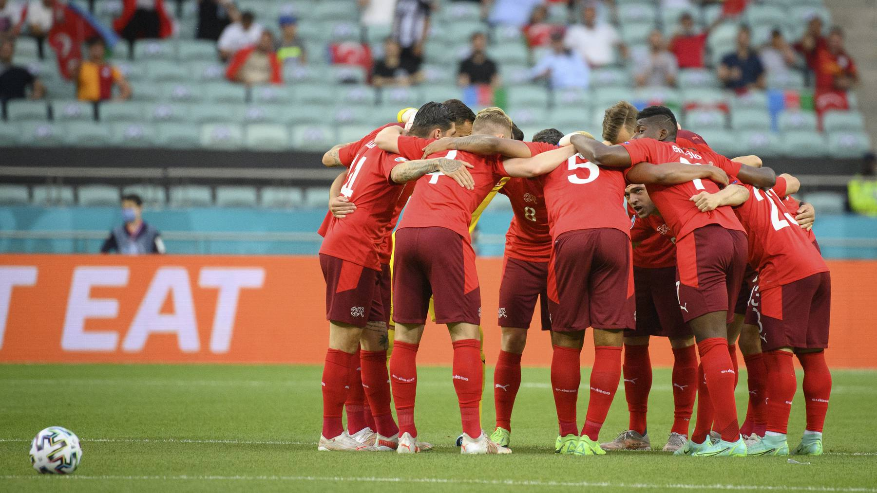 Switzerland's soccer national team players encourage each other before the Euro 2020 soccer tournament group A match between Switzerland and Turkey at the Olympic stadium, in Baku, Azerbaijan, Sunday, June 20, 2021.