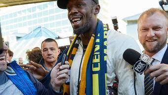 Der Rummel ist gross, als Jamaikas Sprint-Legende Usain Bolt am Flughafen von Sydney eintrifft