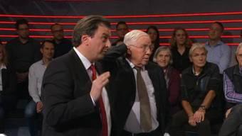 Gewerkschafter Corrado Pardini und Christoph Blocher stehen auf der selben Seite, zumindest im Arena-Studio.