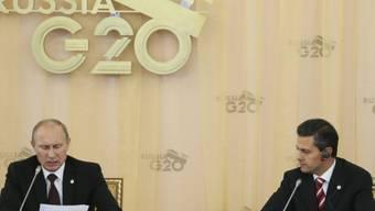 Zwei im Konflikt mit den USA: Putin (links) und Peña Nieto