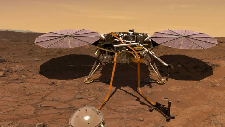 Das Seismometer (vorne) soll Marsbeben registrieren. Aus den Daten werden die Forschenden auf die innere Struktur des Roten Planeten schliessen. (Künstlerische Darstellung)