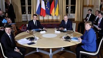 Der französische Präsident Emmanuel Macron hat im Elysée-Palast den ukrainischen Präsidenten Wolodymyr Selenskyj, die deutsche Kanzlerin Angela Merkel und den russischen Präsidenten Wladimir Putin zum Ukraine-Gipfel empfangen.