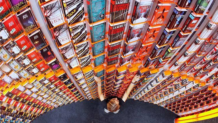 Mit einem Umsatz von jährlich 148 Milliarden US-Dollar erwirtschaften die Buchproduzenten mehr als die Kino- oder Tonträger-Industrie. Michael Probst/AP/Keystone