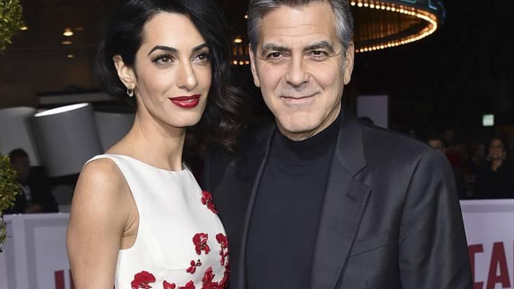 Engagieren sich für syrische Flüchtlingskinder im Libanon: Filmstar George Clooney und seine Frau Amal, die im Libanon aufwuchs. (Archivbild)
