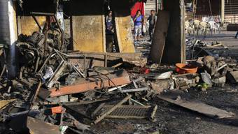Szene in Sadr City nach einem Autobombenanschlag (Archiv)