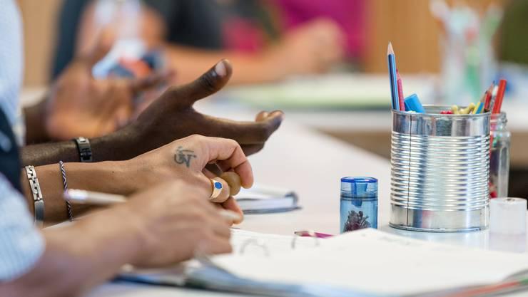 Flüchtlinge, Asylsuchende im Deutschkurs, Integrationskurs