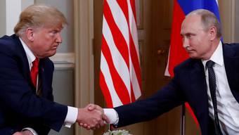 einer Wellenlänge: US-Präsident Trump und sein russischer Amtskollege Putin in Helsinki.