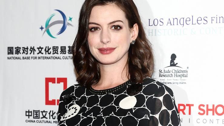 Von Schauspielerinnen wird erwartet, nach einer Schwangerschaft innert Kürze wieder rank und schlank zu sein. Diesem Druck will sich Anne Hathaway nicht beugen. (Archivbild)