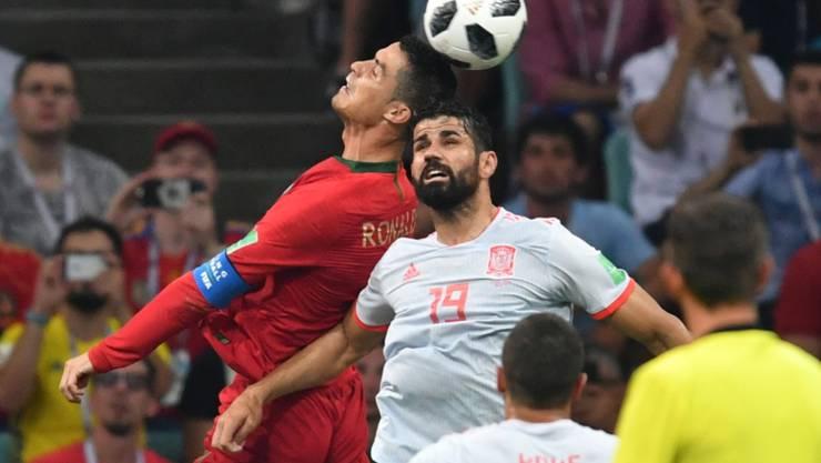 Diego Costa (rechts) und Cristiano Ronaldo (links) haben ihre Treffsicherheit in ihrem ersten WM-Spiel in Russland bewiesen. Beim 3:3 im Direktduell traf Ronaldo für Europameister Portugal dreifach, Costa für Spanien doppelt