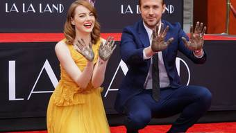 Hollywood-Schauspielerin Emma Stone und Kollege Ryan Gosling standen schon dreimal gemeinsam vor der Kamera - und jetzt in Zement.