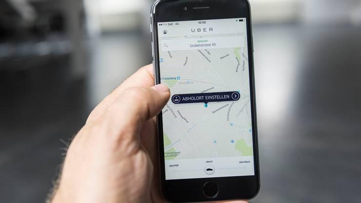 Die Uber-App: Der einstige Höhenflieger wird von Regulatoren herabgezogen