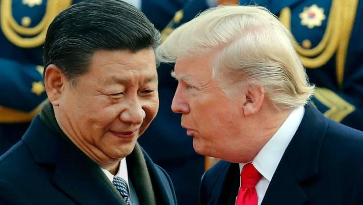 US-Präsident Donald Trump und der chinesische Präsident Xi Jinping bei einem Treffen Ende. Die Eintracht der beiden hat offenbar ein Ende. (Archivbild)