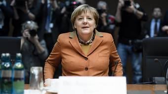 Die deutsche Kanzlerin Angela Merkel geht geschwächt in die Koalitionsverhandlungen mit FDP und Grünen.