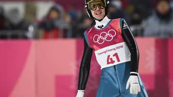 Simon Ammann lächelt nach erfolgreicher Qualifikation für das Springen von der Grossschanze