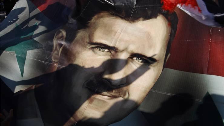 Der syrische Staatschef Baschar al-Assad sitzt auch 17 Monate nach Beginn des Aufstands fest im Sattel.