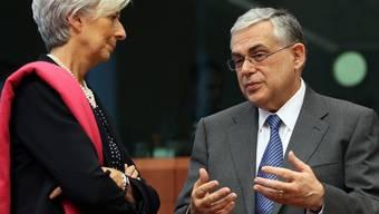Der griechische Ministerpräsident Lucas Papademos im Gespräch mit IMF-Direktorin Christine Lagarde