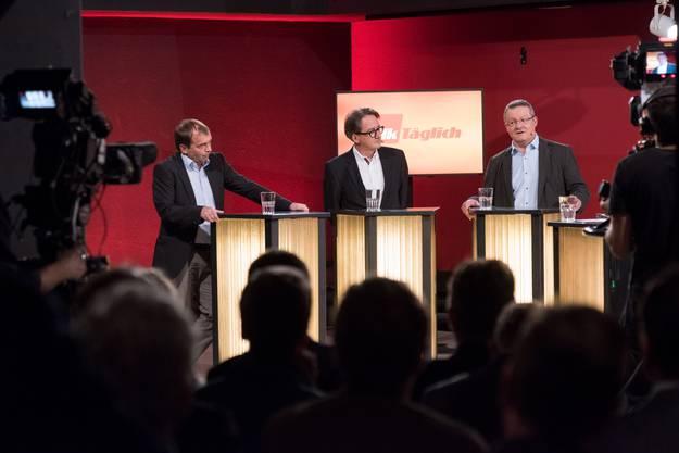 Jürg Caflisch (links, SP) und Erich Obrist (Mitte, parteilos).