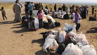 Immer mehr Menschen in Syrien fliehen (Archiv)
