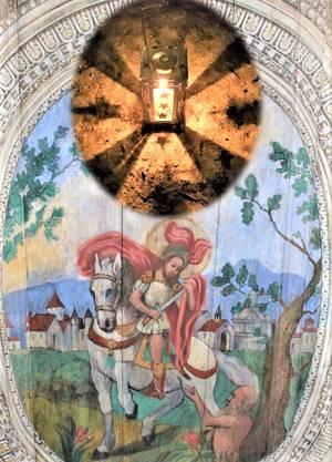 Hl. Martin von Tours teilt den Mantel vor der Stadt Amiens, über ihm und dem Bettler strahlt die Martinilaterne