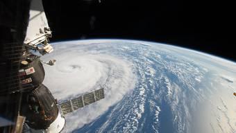"""Eine riesige Wolkenspirale: Taifun """"Noru"""" vom Weltall aus fotografiert."""