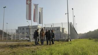 Migration an der Quelle erforschen: Rundgang beim Bässlergut.
