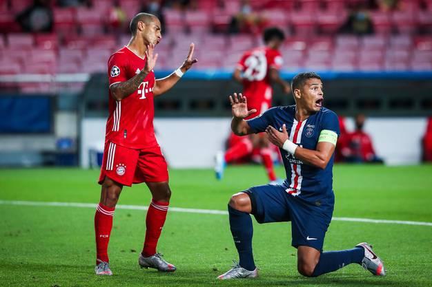 Bayerns Thiago Alcántara (l.) und Paris Saint-Germains Thiago Silva.