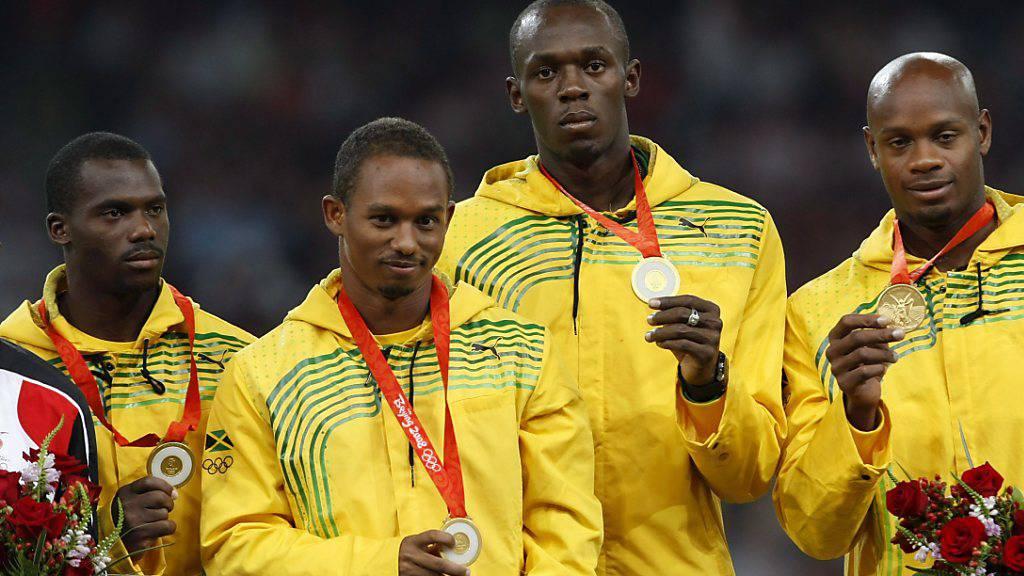 War 2008 gedopt und muss Staffel-Gold wie seine Teamkollegen zurückgeben: Nesta Carter (ganz links)