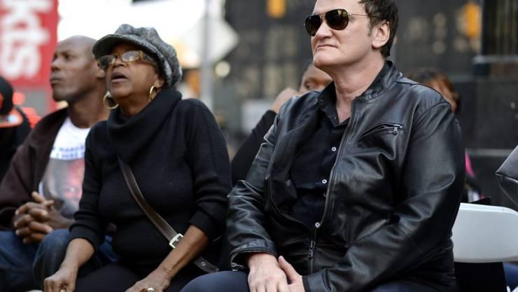 Gewalt im Film? Kein Problem für Quentin Tarantino (r). In der Realität aber schon: Am Donnerstag nahm er an einer Demo gegen Polizeigewalt teil.