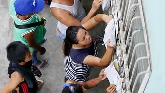 Wählerinnen und Wähler auf den Philippinen.