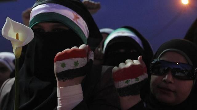 Frauen aus Syrien demonstrieren in Jordanien gegen präsident Assad
