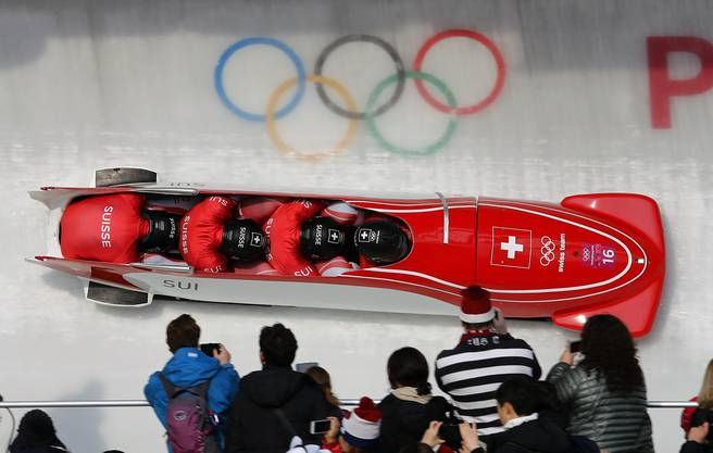 Driver Rico Peter, Michael Kuonen, Simon Friedli and Thomas Amrhein of Switzerland take turn 14 during their third heat during the four-man bobsled competition final at the 2018 Winter Olympics in Pyeongchang, South Korea, Sunday, Feb. 25, 2018. (AP Photo/Andy Wong)