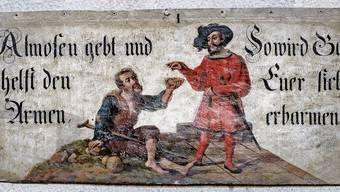 Ein Wandbild aus dem Basler Münster: «Almosen gebt und helft den Armen, so wird Gott Euer sich erbarmen.»