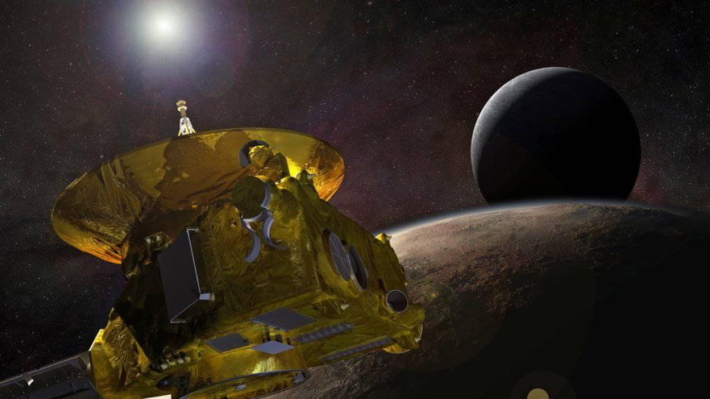 2015 passierte die Nasa-Sonde «New Horizons» als erster Flugkörper Pluto. Nun ist ihr das am weitesten von der Erde entfernte Rendezvous mit einem Himmelskörper geglückt. (Archivbild)