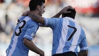 Ezequiel Lavezzi (r.) sichert Argentinien einen Punkt