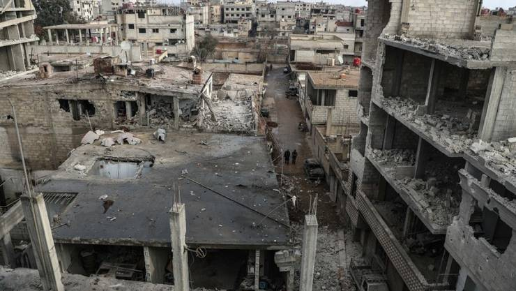 Zerstörte Häuser in der Stadt Mesraba in der Region Ost-Ghuta. Für die Bombardierungen macht die Syrische Beobachtungsstelle für Menschenrechte syrische und russische Kampfflugzeuge verantwortlich.