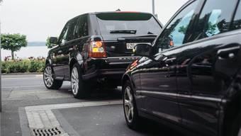 Viele Schweizer stehen auf grosse Autos, die zu viele Schadstoffe ausstossen.Keystone